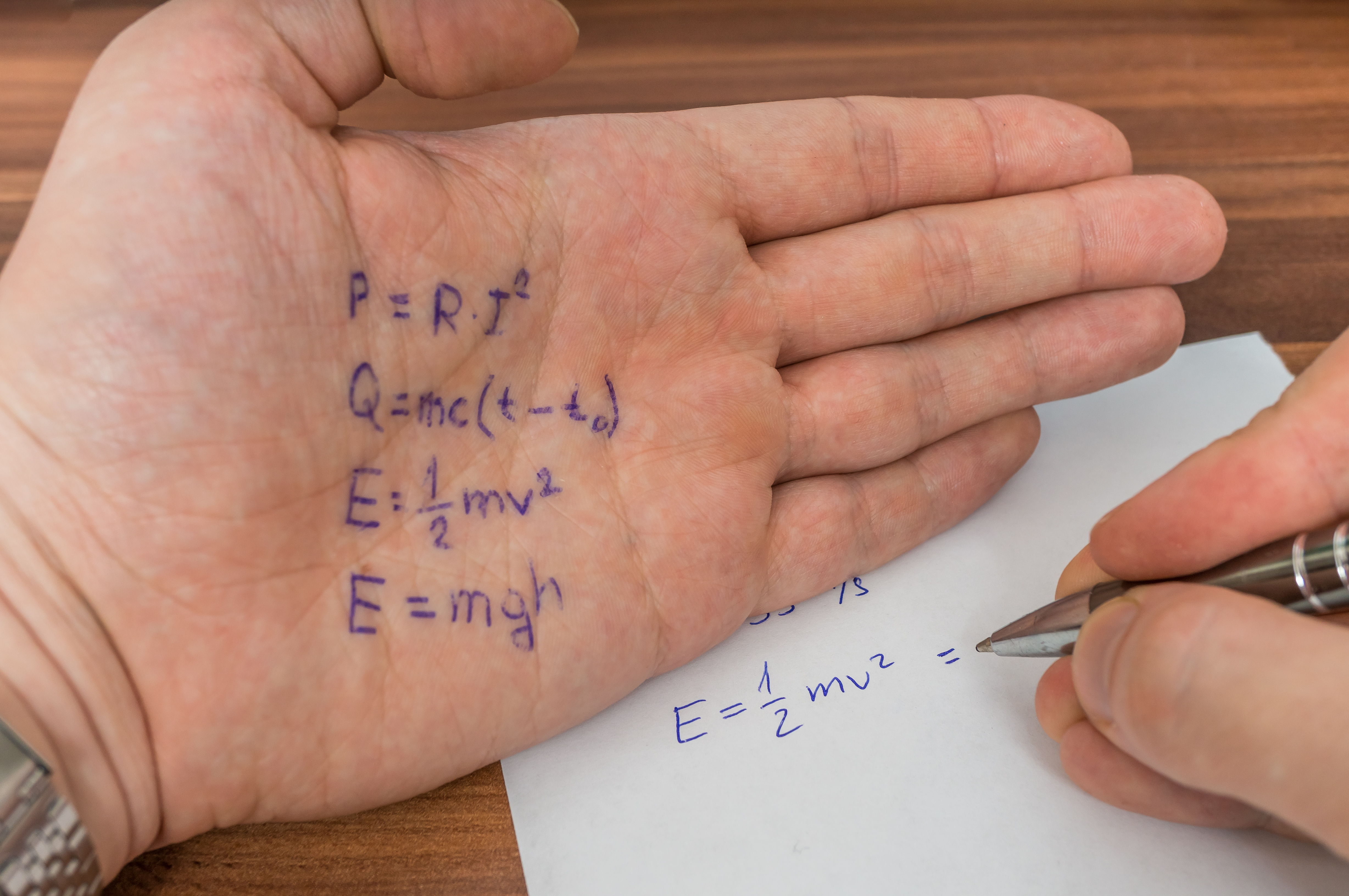stop cheating on digital assessments student is cheating during exam cheat sheet formula written on his hand